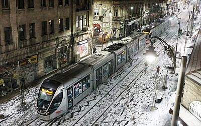 The Jerusalem Light Rail on a snow covered Jaffa Road on Wednesday (photo credit: Miriam Alster/Flash90)