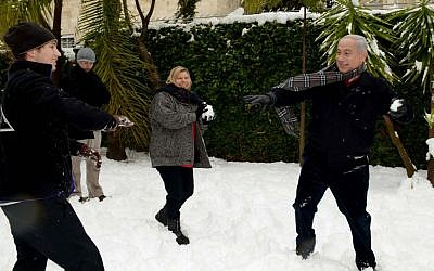 Gearing up for the elections? Prime Minister Benjamin Netanyahu has a snowball fight with his family in Jerusalem on Thursday (photo credit: Avi Ohayon/GPO/Flash90)