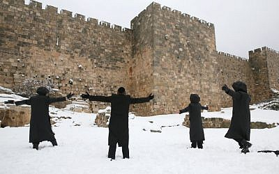 Ultra-Orthodox Jewish men seen playing near the Old City walls in Jerusalem, on Wednesday, Jan 10 (photo credit: Nati Shohat/Flash90)