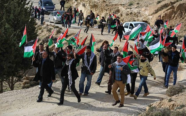 Palestinian activists marching to set up the Bab el-Shams outpost on Friday. (photo credit: Flash90)