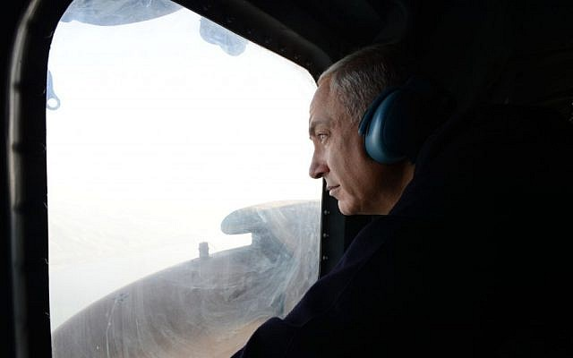 Prime Minister Benjamin Netanyahu looks down on Israel's north during a helicopter ride, January 13, 2013 (photo credit: Kobi Gideon/GPO/Flash90)