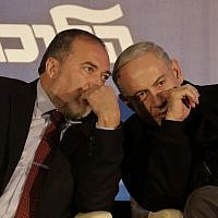 Avigdor Liberman (left), and Benjamin Netanyahu sharing a private word in January 2013. (Tsafrir Abayov/Flash90)