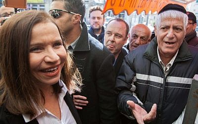 Labor party chief Shelly Yachimovich makes a campaign stop at Jerusalem's Mahane Yehuda market on Wednesday (photo credit: Yonatan Sindel/Flash90)