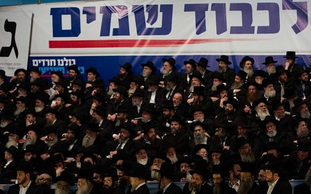 "Supporters of the ultra-Orthodox United Torah Judaism party gather at Jerusalem's International Convention Center for a party rally on Thursday, January 17. The banner reads ""Lichvod shamayim"" -- for heaven's sake. (Photo credit: Yonatan Sindel/Flash90)"