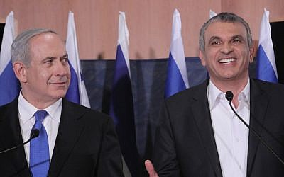 Prime Minister Benjamin Netanyahu and former Communications Minister Moshe Kahlon at a press conference that was banned from broadcast by the elections committee. Netanyahu announced Kahlon as newly appointed head of the Israel Lands Administration. January 20, 2013. (photo credit: Miriam Alster/FLASH90)