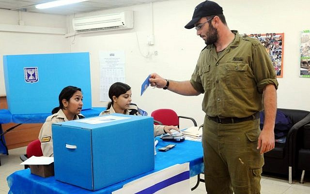 An Israeli soldier voting at a Navy base in Ashdod (Photo credit: Yossi Zeliger/FLASH90)