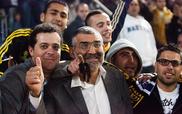 Otzma Leyisrael #2 Michael Ben Ari attends a soccer game between Beitar Jerusalem and Hapoel Tel Aviv on Monday evening, the day before Israeli elections. (photo credit: Roy Alima/Flash90)