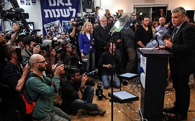 Yesh Atid leader Yair Lapid speaks to reporters after results revealed him to be the big winner of the elections on Tuesday, Jan. 22 (photo credit: Avishag Shaar Yashuv/Flash90)