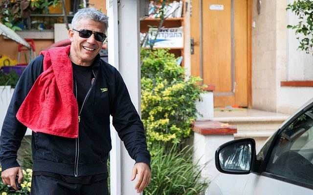 Yair Lapid, chairman of the Yesh Atid party, outside his home on January 22 (photo credit: Avishag Shaar Yashuv/Flash 90)