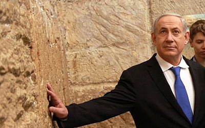 Prime Minister Benjamin Netanyahu goes to the Western Wall after casting his vote (Photo credit: Marc Israel Sellem/POOL/FLASH90)