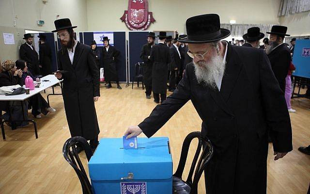 Ultra-Orthodox men in the Tel Aviv suburb of Bnei Brak casting their ballots on Tuesday. (photo credit: Nati Shohat/Flash90)