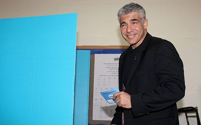 Yair Lapid, head of the Yesh Atid party, casts his vote in a polling station in Tel Aviv, January 22, 2013. (Photo credit: Gideon Markowicz/Flash90)