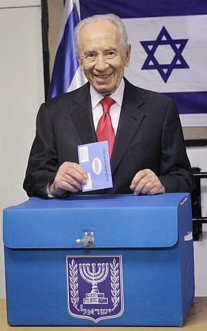 President Shimon Peres casts his vote at a polling station in Jerusalem (photo credit: Miriam Alster/Flash90)