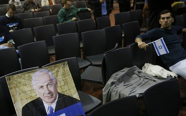 The reduced ranks of Likud supporters react to the TV exit polls, January 22, 2013. (Photo credit: Miriam Alster/FLASH90)