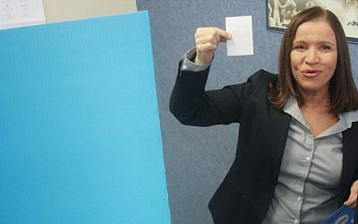 Leader of the Labor Party Shelly Yachimovich stepping out from behind the voting booth (photo credit: Flash90)