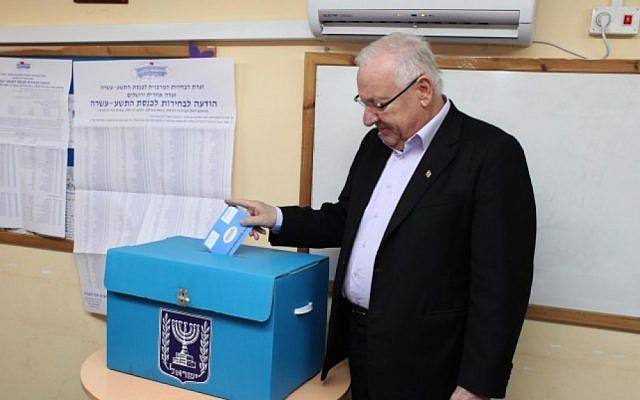 Reuven Rivlin casts his ballot on Tuesday (photo credit: Yoav Ari Dudkevitch/Flash90)