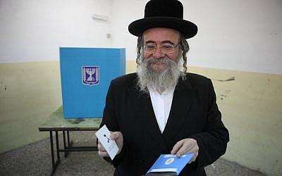 An ultra-Orthodox man casts his vote in Bnei Brak on January 22, 2013. (photo credit: Yaakov Naumi/Flash90)