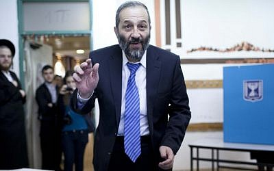 Aryeh Deri of the Shas party casts his vote on Tuesday (photo credit: Yonatan Sindel/Flash90)