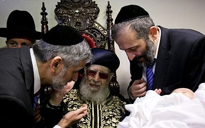 From left: Eli Yishai, Rabbi Ovadia Yosef and Aryeh Deri, the leaders of the ultra-Orthodox Shas party attend a circumcision in January, 2013. (photo credit: Yonatan Sindel/Flash90)