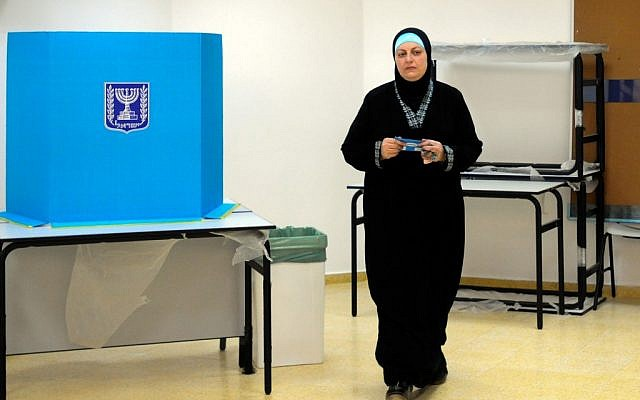 An Arab-Israeli woman casts her vote in the Arab city of Tira, January 22, 2013 (photo credit: Yossi Zeliger/Flash90)