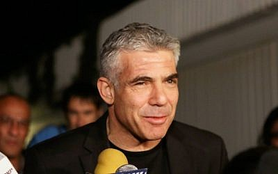 Yesh Atid leader Yair Lapid speaks to the press outside his home in Tel Aviv on Wednesday (photo credit: Flash90)