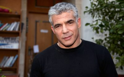 Yesh Atid leader Yair Lapid speaks to reporters outside his house on Friday, January 25 (photo credit: Gideon Markowicz/Flash90)