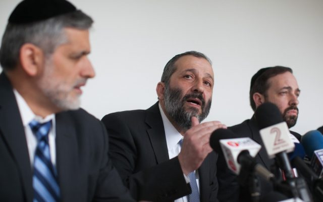 Shas co-leaders Ariel Atias (right), Aryeh Deri (center) and Eli Yishai address the party on January 27. (photo credit: Yonatan Sindel/Flash90