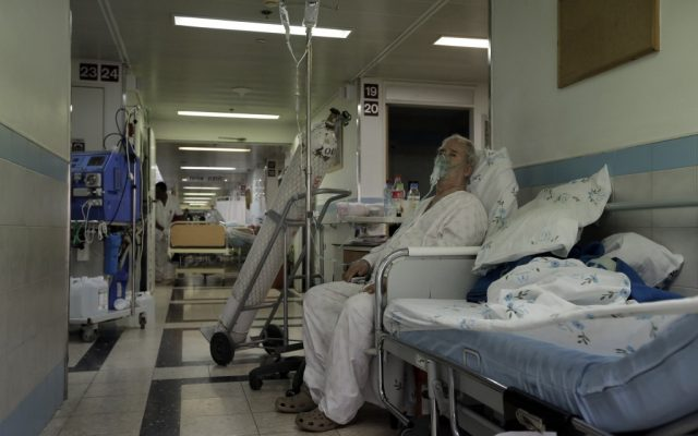 A patient in the hallway of Barzilai Hospital in Ashkelon. (photo credit: Tsafrir Abayov/Flash90)