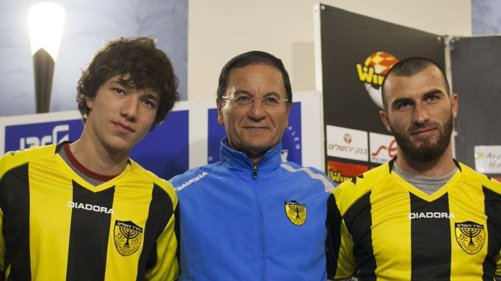 Beitar Jerusalem head coach Eli Cohen, center, flanked by Gabriel Kadiev, left, and Zaur Sadayev at a press conference last month (photo credit: Yonatan Sindel/Flash90)