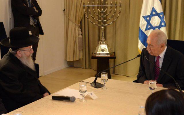 President Shimon Peres meets with United Torah Judaism's Yaakov Litzman, in Jerusalem, January 31 (photo credit: Mark Nayman/GPO/Flash90)