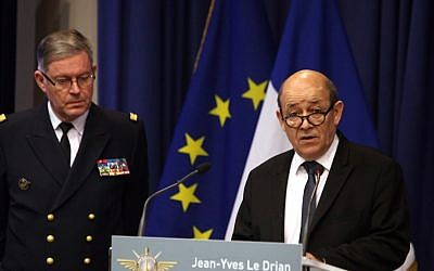 Franch Defense Minister Jean-Yves Le Drian, right, speaks as French Army Chief of Staff Adm. Edouard Guillaud stands during a press conference, in Paris, Saturday, January 12, 2013 (photo credit: AP/Thibault Camus)