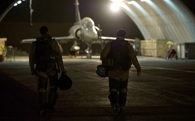 This picture released by the French Army Communications Audiovisual office (ECPAD) shows French fighter pilots walking toward their Mirage 2000 D, at Kossei camp in N'Djamena, Chad, Friday, Jan. 11, 2013 (photo credit: AP Photo/ R.Nicolas-Nelson, Ecpad)