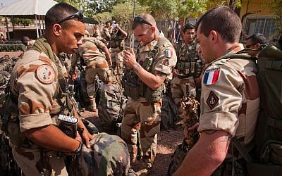 This picture released by the French Army Communications Audiovisual office (ECPAD) shows French soldiers getting ready before boarding to Bamako, the capital from Mali, at Kossei camp in N'Djamena, Chad, Friday, Jan. 11, 2013.  (Photo credit: AP/R.Nicolas-Nelson ECPAD)