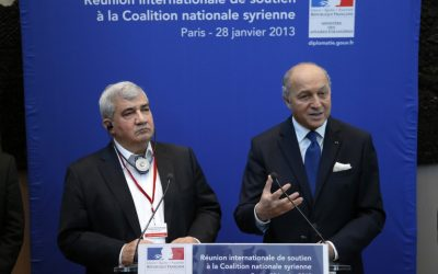 French Foreign Minister Laurent Fabius, right, flanked by Syrian National Coalition vice-president Riad Seif attend a press conference during the International support meeting of the Syrian National Coalition in Paris, Monday, Jan. 28, 2013 (photo credit:AP/Francois Mori)