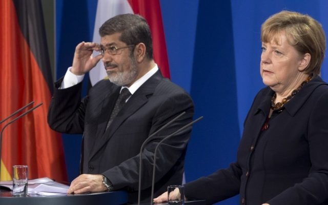 German Chancellor Angela Merkel, and President of Egypt Mohammed Morsi,  address the media during a joint press conference after a meeting at the chancellery in Berlin, Germany, Wednesday, Jan. 30, 2013. (photo credit: AP/Michael Sohn)