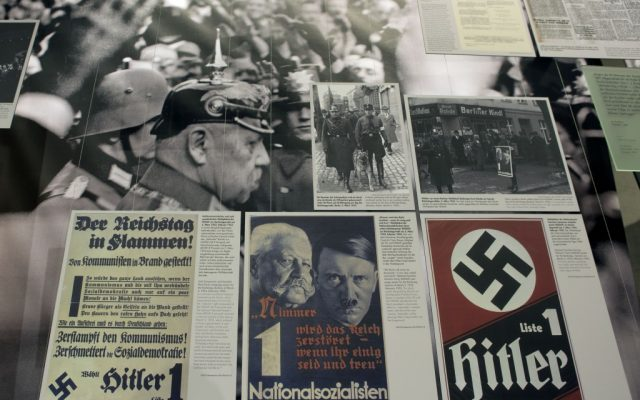 A poster, front center, showing Adolf Hitler, right, and Reich Chancellor Paul von Hindenburg, left, is pictured at the Topography of Terror museum in Berlin, Germany, Wednesday, January 30, 2013. (photo credit: AP Photo/Michael Sohn)