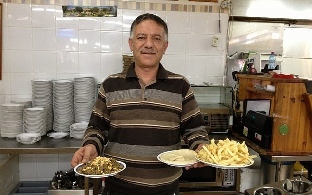 A waiter at the Lebanese restaurant in Abu-Ghosh (photo credit: Elhanan Miller/Times of Israel)