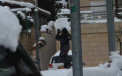 Is that a snowman abdomen or a really badass snowball? A man conducts a delivery in Jerusalem, Thursday (photo credit: Daniel Laufer)