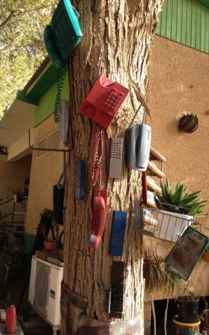 Painted phones and other gadgets in the Mashabim garden (photo credit: Jessica Steinberg/Times of Israel)