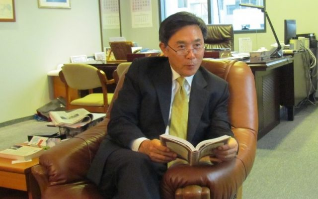 South Korea's ambassador to Israel, Kim il-soo, holding an abridged version of the Talmud in his Herzliya office (photo credit: courtesy South Korean embassy in Israel)