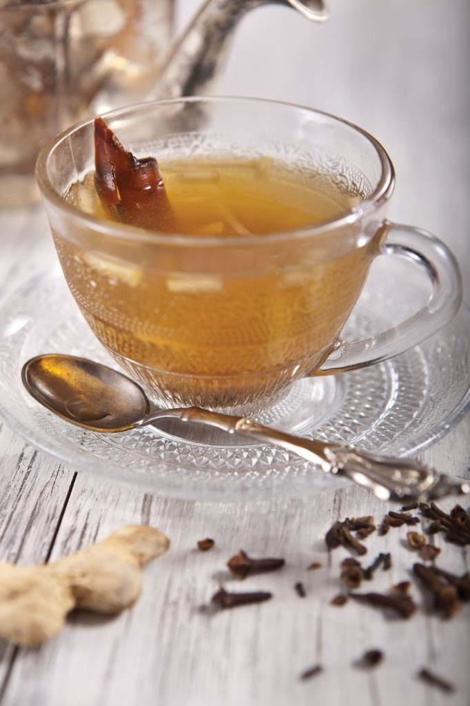 A glass of hot piping apple chai, served with a stick of cinnamon or carob, for Tu B'shvat (Courtesy Phyllis Glazer)