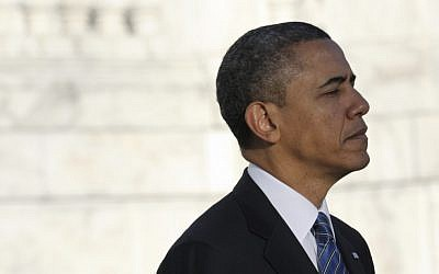 US President Barack Obama pauses after placing a wreath at Arlington Cemetery on Sunday, January 20, 2013. (photo credit: AP/Susan Walsh)