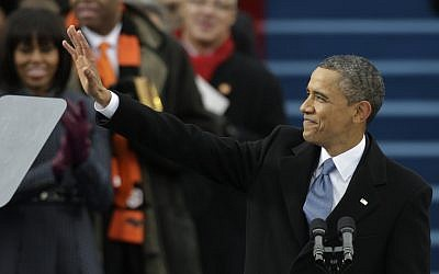 US President Barack Obama waves after his ceremonial swearing-in at the US Capitol during the 57th Presidential Inauguration in Washington, Monday, Jan. 21, 2013. (photo credit: AP/Pablo Martinez Monsivais)