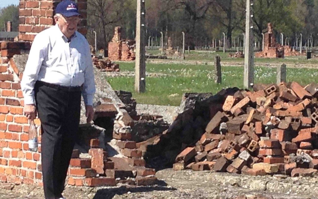 "Now 87, Israel ""Izzy"" Arbeiter visits Auschwitz, which he survived as a young man while cleaning latrines. (Courtesy of the WWII Foundation)"