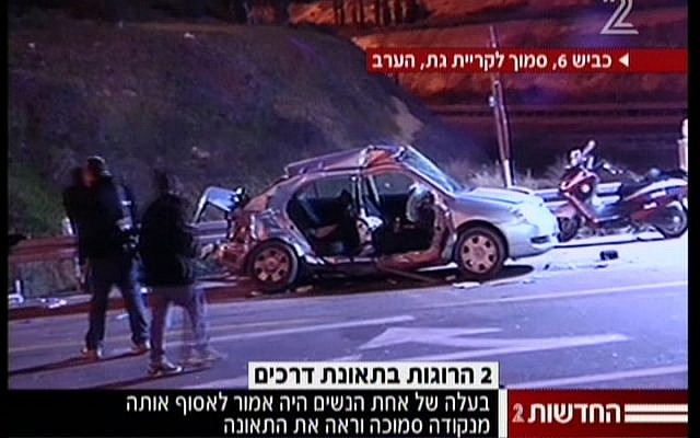 Police investigators approach a vehicle in which two hitchhikers were killed, near Kiryat Gat, on Sunday, January 13. (photo credit: Channel 2 News)