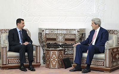 Syrian President Bashar Assad meets with Sen. John Kerry (D-MA), President Barack Obama's choice to become the next secretary of state, in Damascus, Syria in 2010. (photo credit: AP/SANA)