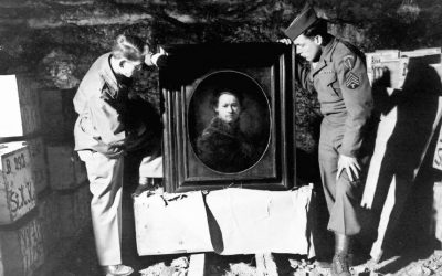 Two US soldiers, shown in 1945 or 1946 inspecting a Rembrandt self-portrait in a salt mine where the Nazis stored stolen and hidden art (photo credit: Courtesy National Archives and Records Administration)