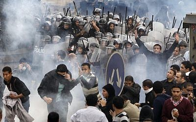 In this file photo from January 28, 2011, Egyptian anti-government protesters clash with riot police in Cairo, Egypt (photo credit: AP/Ben Curtis)