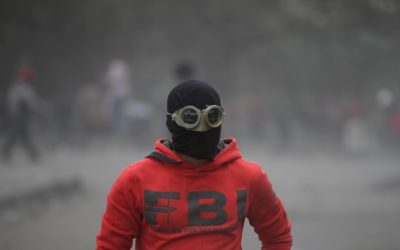 An Egyptian protester part of the Black Bloc, clashes with riot police, not seen, near Tahrir Square, Cairo, Egypt, Monday, Jan. 28, 2013 (photo credit: AP/Khalil Hamra)