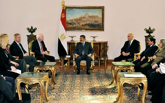 Egyptian President Mohammed Morsi (center) meets with Republican Sen. John McCain (center left) at the Presidential Palace in Cairo on Wednesday, January 16, 2013. (photo credit: AP/Egyptian Presidency)